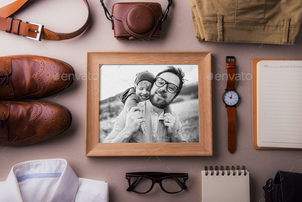 Fathers day greeting card concept. A photo of a dad and toddler son. Flat lay. - Stock Photo - Images