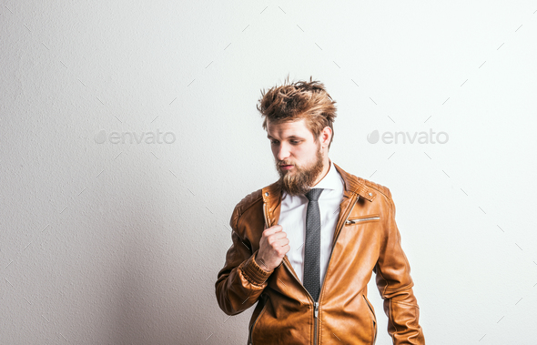 Portrait of a young hipster man in a studio on a white background. Copy space. - Stock Photo - Images