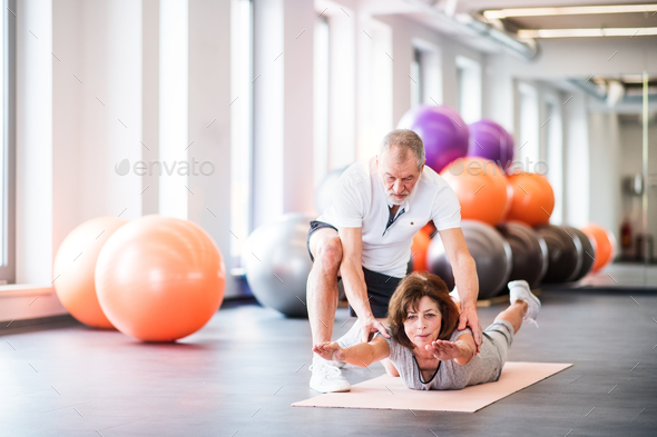 Senior physiotherapist working with a female patient. - Stock Photo - Images