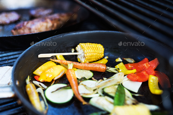 Vegetables on the grill. Garden party outside in the backyard. - Stock Photo - Images