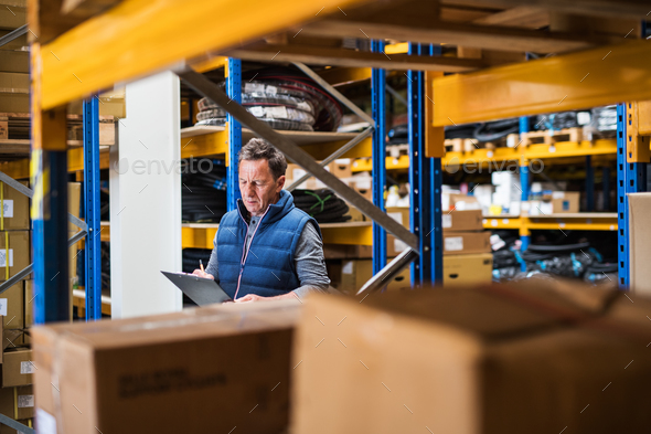 Portrait of a senior male warehouse worker or a supervisor. - Stock Photo - Images