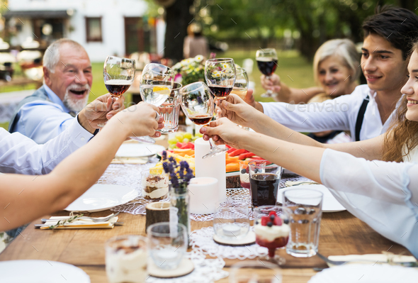 Garden party or family celebration outside in the backyard. - Stock Photo - Images
