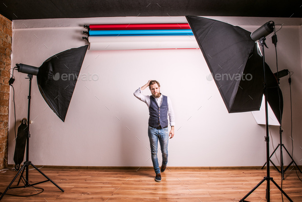 Portrait of a young hipster man or model in a studio. Copy space. - Stock Photo - Images