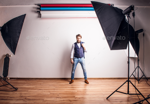 Portrait of a young hipster man in a studio. - Stock Photo - Images