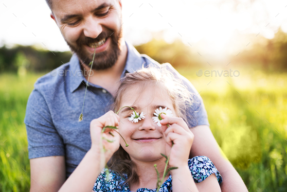 Father with a small daughter having fun in spring nature. - Stock Photo - Images