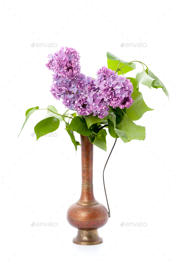 A bouquet of pink lilac in an oriental copper jar on a clean whi - Stock Photo - Images