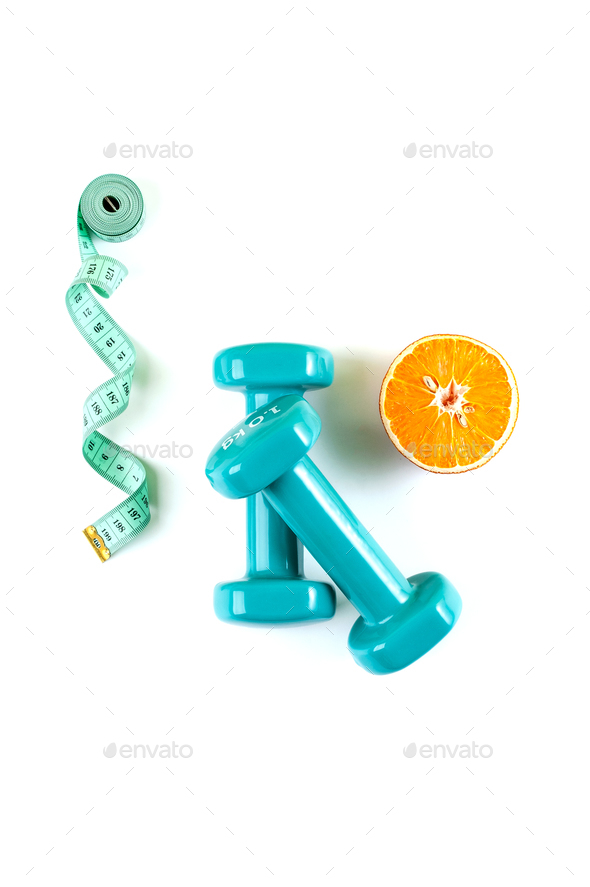 Dumbbells, a centimeter and half an orange on a pure white backg - Stock Photo - Images