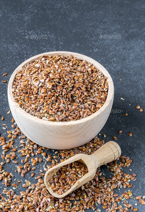 A Wooden Bowl of Linseed - Stock Photo - Images