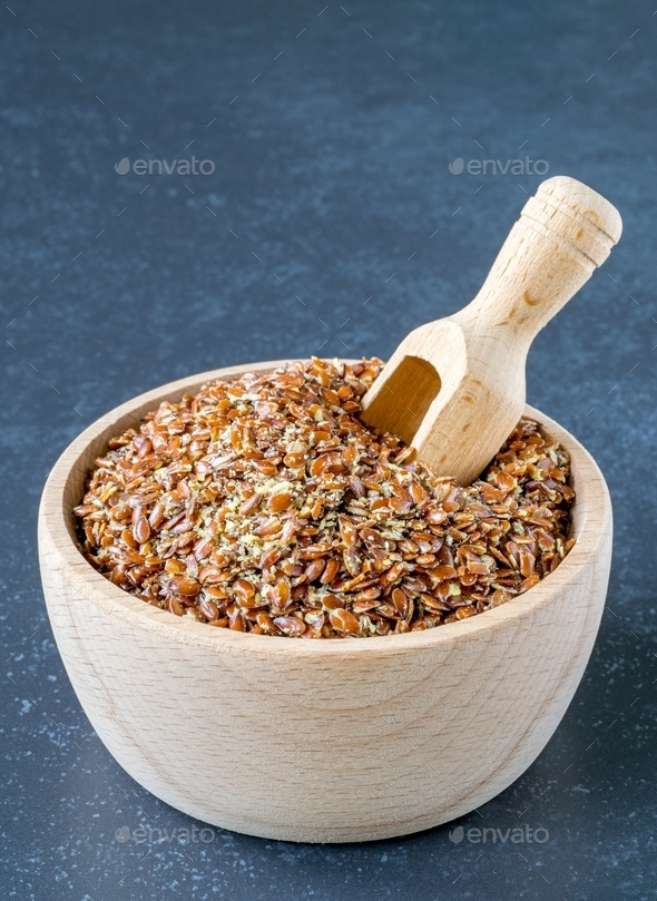 A Wooden Bowl with Linseed - Stock Photo - Images