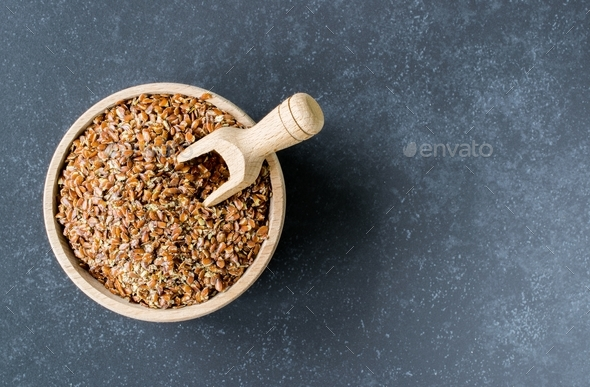 Linseed in a Wooden Bowl - Stock Photo - Images