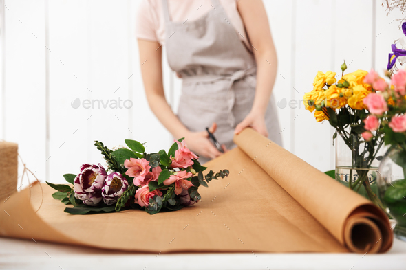 Cropped photo of florist woman working - Stock Photo - Images
