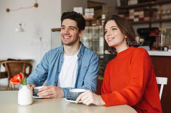 Happy couple woman and man smiling and looking aside, while rest - Stock Photo - Images