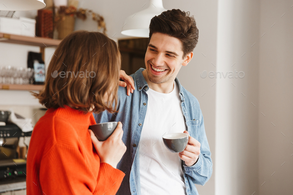 Caucasian people woman and man in casual wear smiling to each ot - Stock Photo - Images