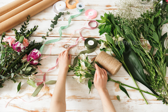Cropped image of florist woman's hands - Stock Photo - Images