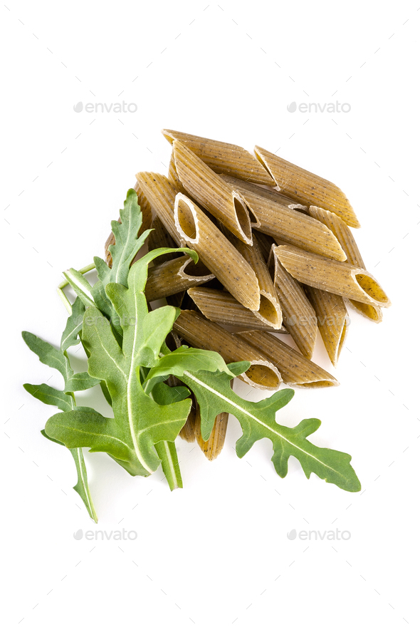 Italian pasta penné Rigate with spinach and arugula on a white - Stock Photo - Images