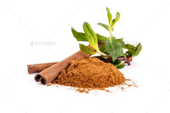 Two sticks and ground cinnamon and mint leaves on a white backgr - Stock Photo - Images