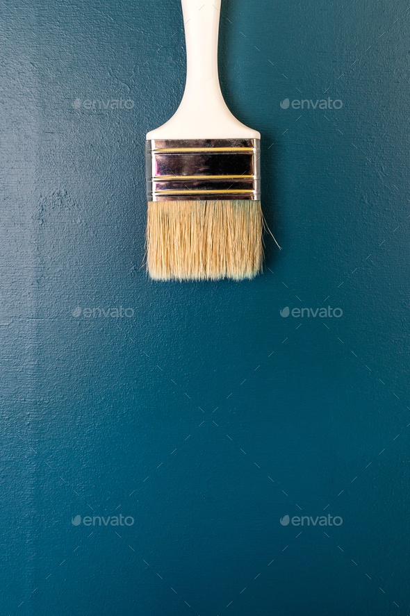 Paint brush on a dark blue background. Free space for text. - Stock Photo - Images