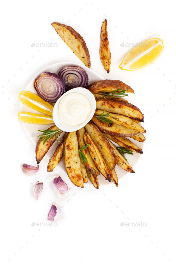 Baked potatoes and onion with rosemary, garlic and aioli sauce o - Stock Photo - Images