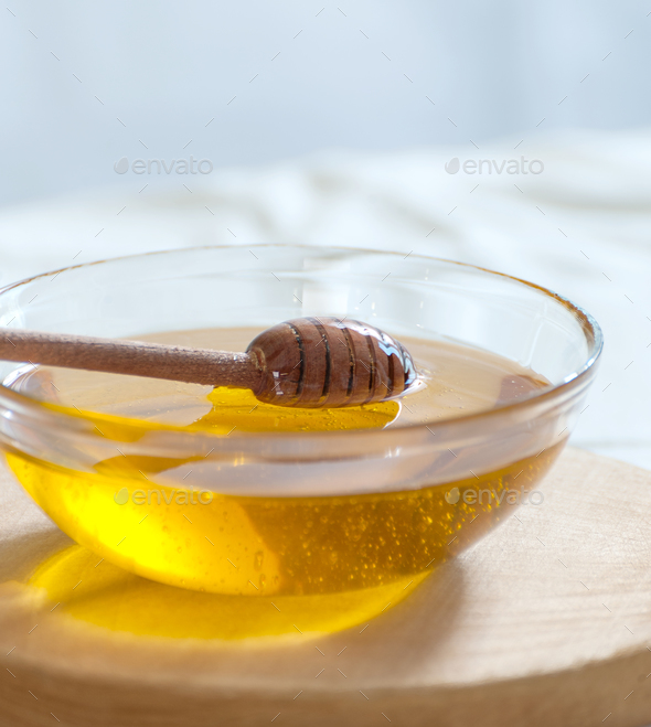 Lime honey in a glass pial on a light background. - Stock Photo - Images