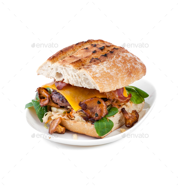 Burger handmade with beef chop and mushrooms chanterelles on an - Stock Photo - Images