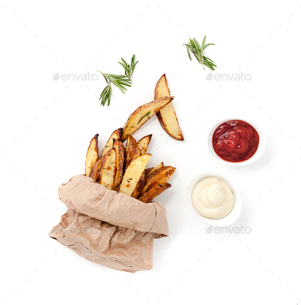 Slices of baked potatoes, ketchup, creamy sauce and grilled onio - Stock Photo - Images