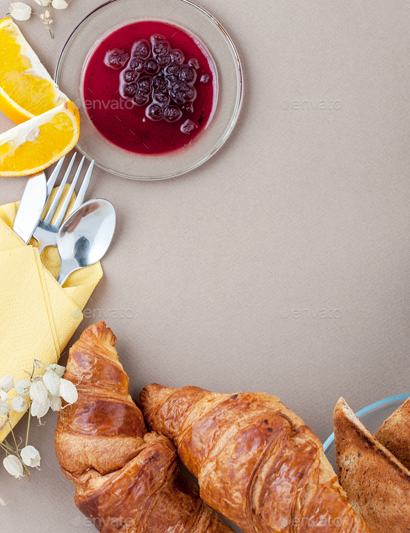 French breakfast - croissants, toast and oranges, on a light bro - Stock Photo - Images