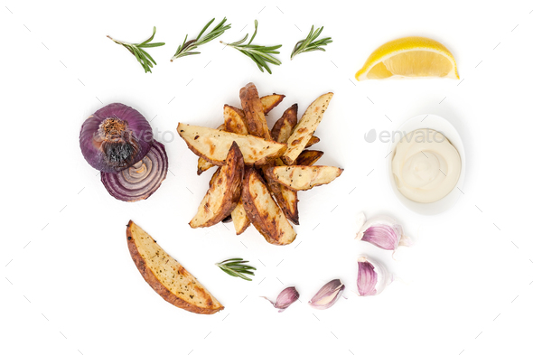 Slices of baked potatoes, ketchup, cream sauce and grilled onion - Stock Photo - Images