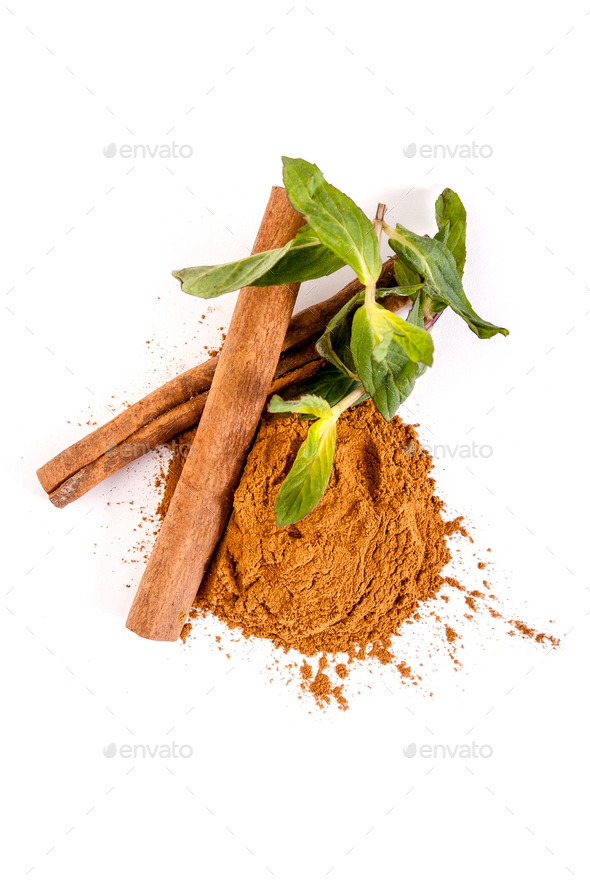 Whole and ground cinnamon and mint leaves on a white background. - Stock Photo - Images