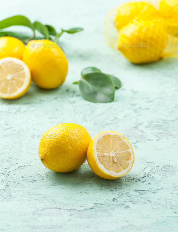 Ripe lemons mint-blue background. - Stock Photo - Images