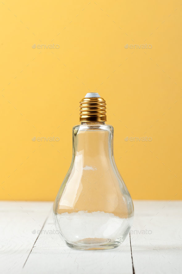 A bottle in the form of an incandescent lamp with a curved cover - Stock Photo - Images