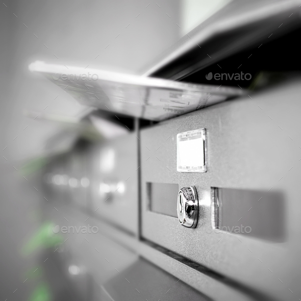 Letterboxes filled - Stock Photo - Images