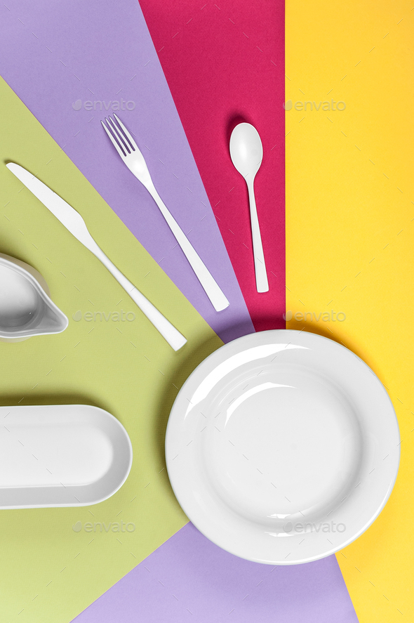 White ceramic ware on a multi-colored background. - Stock Photo - Images
