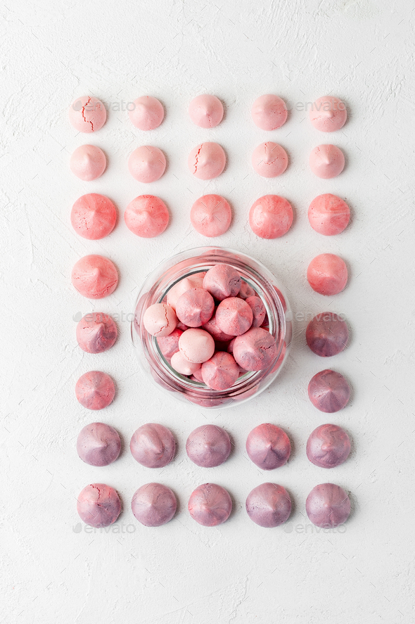 Multicolored meringues in purple-pink colors in a glass jar on a - Stock Photo - Images