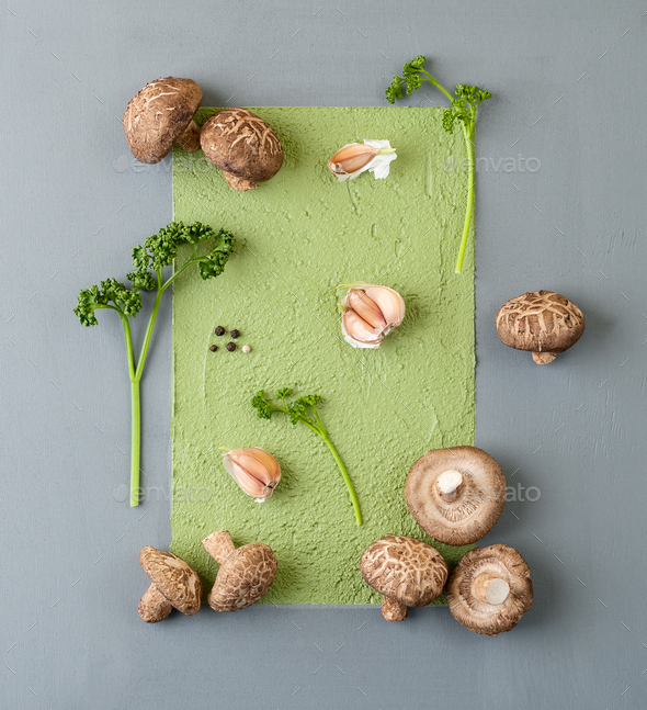 Fresh mushrooms shiitake and stems of curly parsley on an abstra - Stock Photo - Images