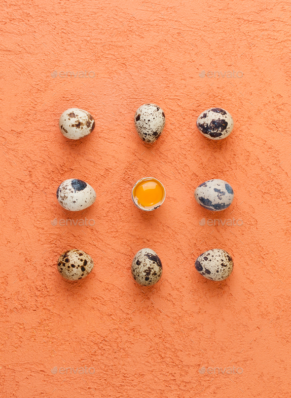 Quail eggs on a textured orange background. Food concept. - Stock Photo - Images