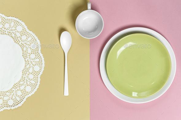 Serving on pastel pink-green background: light green plate, mug, - Stock Photo - Images