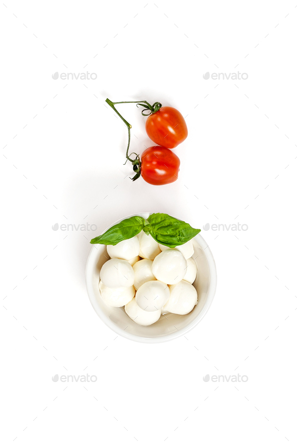 Two fresh Cherry tomatoes and Mozzarella cheese on a clean white - Stock Photo - Images