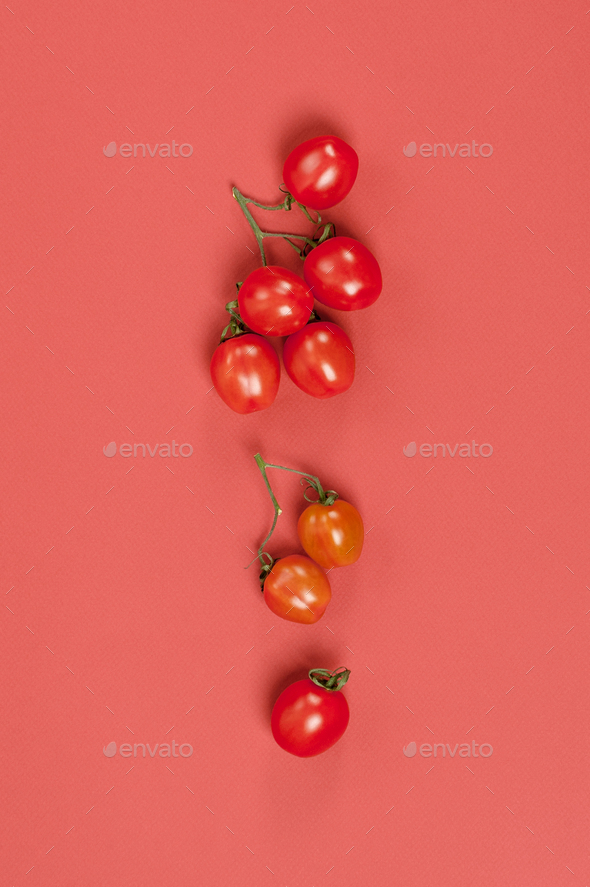 Ripe cherry tomatoes on a pastel red background close-up. - Stock Photo - Images