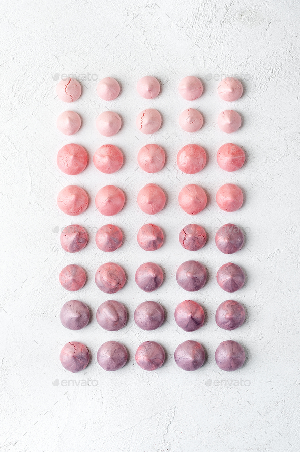 Multicolored strawberry and blueberry meringues in violet-pink s - Stock Photo - Images