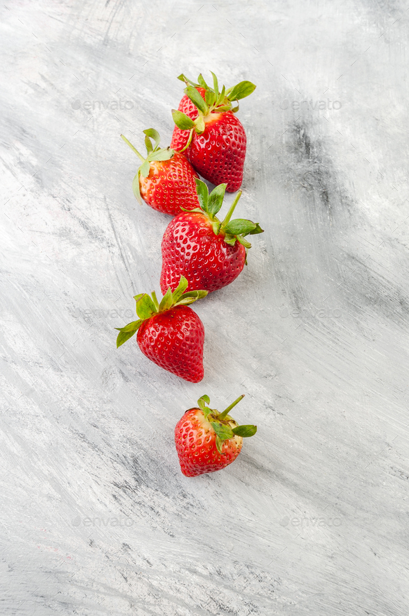 Ripe strawberries on a light gray old table. - Stock Photo - Images
