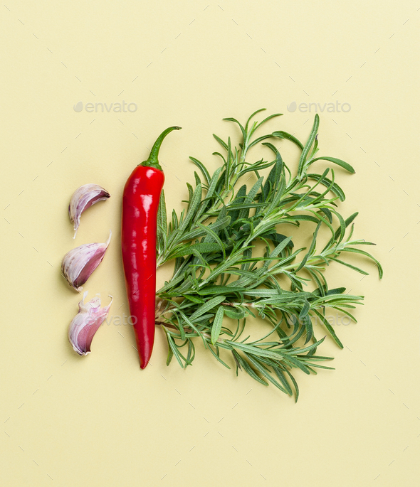 Chili pepper, rosemary and garlic - composition on a light green - Stock Photo - Images