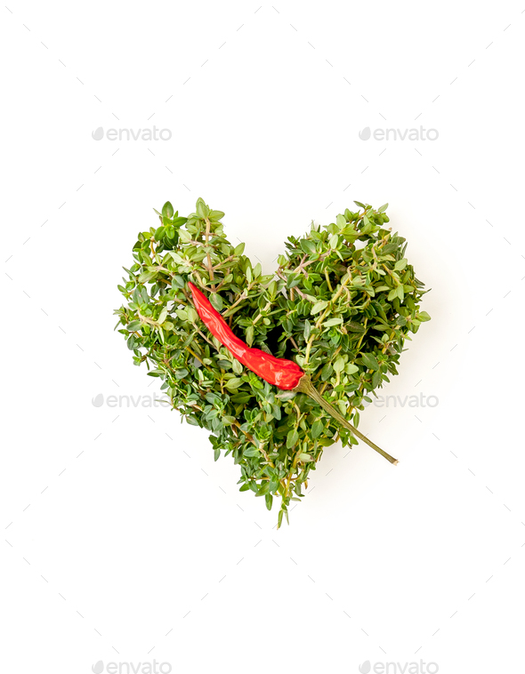 Heart of fresh thyme branches and chili pepper on a clean white - Stock Photo - Images