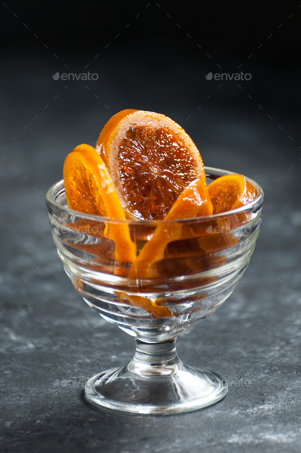 Caramelized oranges in a delicate glass crockery. - Stock Photo - Images