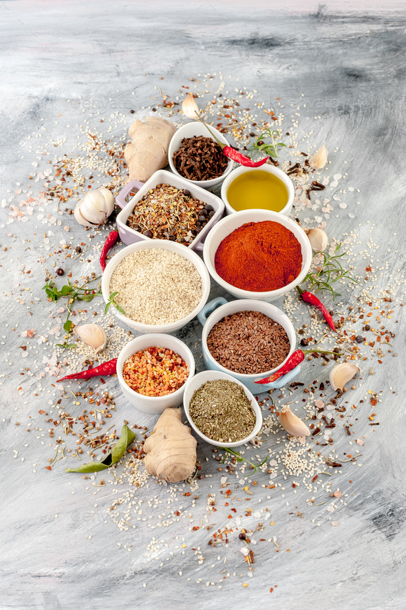 Various spices and cereals in white bowls on a light gray painte - Stock Photo - Images