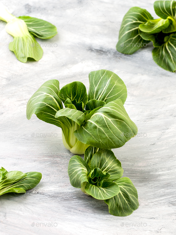 Fresh Pak-choi salad on an old worn table. - Stock Photo - Images