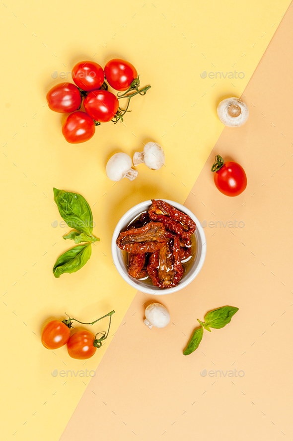 Sun dried tomatoes, champignon mushrooms, fresh tomatoes and bas - Stock Photo - Images