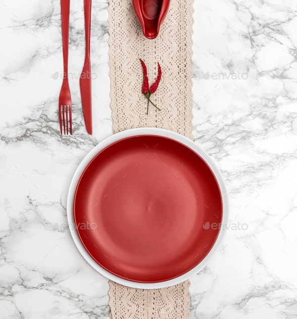 Red dishes and cutlery on the marble table. - Stock Photo - Images