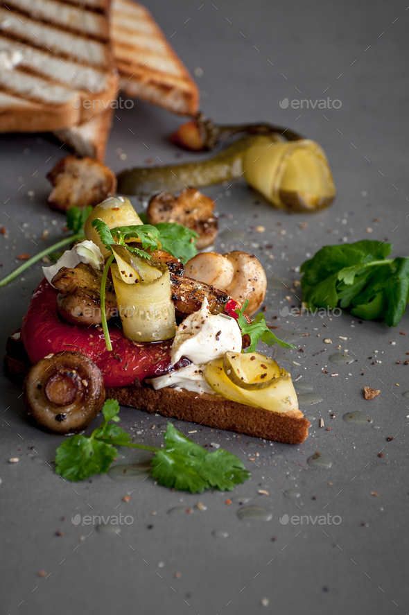 Toast with cream, pepper grilled and fried mushrooms. - Stock Photo - Images