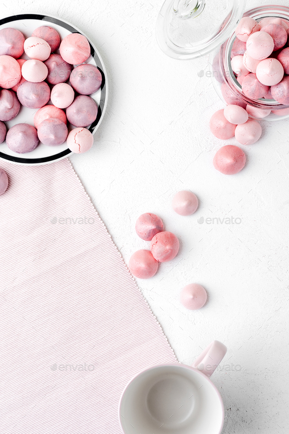Multicolored meringues in purple and gently pink colors on a whi - Stock Photo - Images