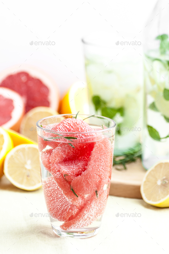 Lemonade with grape seed slices, carbonated water and lemon juic - Stock Photo - Images